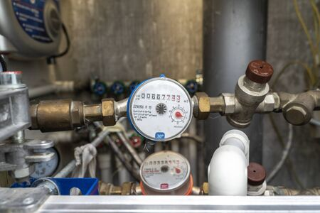 turn off hot water. plumbing cabinet. water meters, collector, water pressure sensor