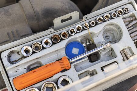 Auto mechanic tool kit. The mechanic has prepared tools for diagnosis and repair. Tools under the hood