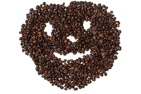 face with a smile from coffee beans. hollow nai white background