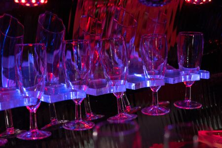 glasses with red and blue lights in a limousine. noise, selective focus, toning