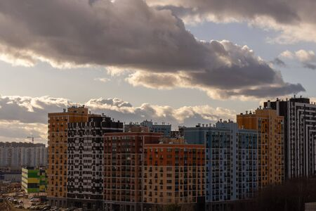 new residential quarter of the metropolis with a beautiful cloudy sky at dusk from a height