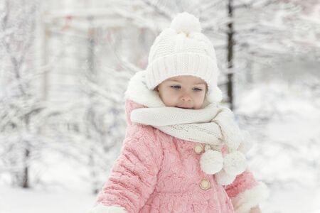 beautiful girl in a pink fur coat in a fabulous snowy forest Фото со стока