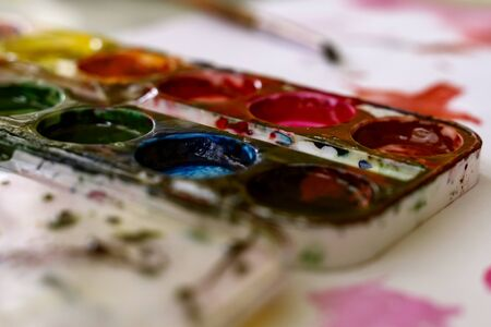 palette with stained watercolor paints