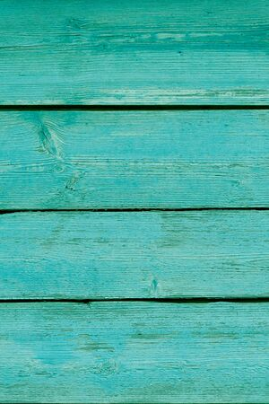 green wooden old planks with blossoming paint