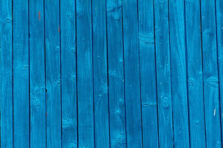 old boards painted with blue paint. blue background