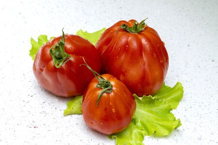 tomatoes and salad on a light background