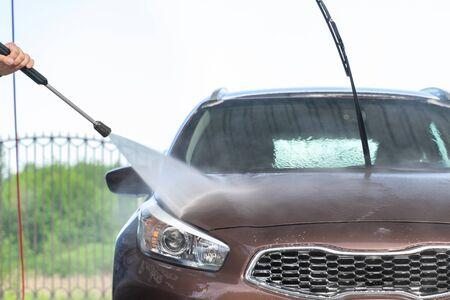 car wash at high pressure outdoors. high pressure moa