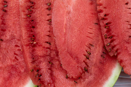 closeup slices of watermelon with pits. juicy and ripe watermelon Banque d'images