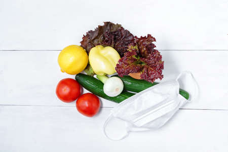antiviral set of vegetables with a disposable mask