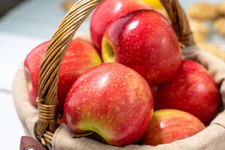 red apples in a basket close up