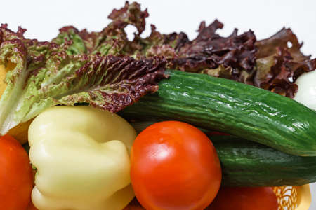 set of summer fresh vegetables close-up. lettuce, cucumber, pepper, tomato