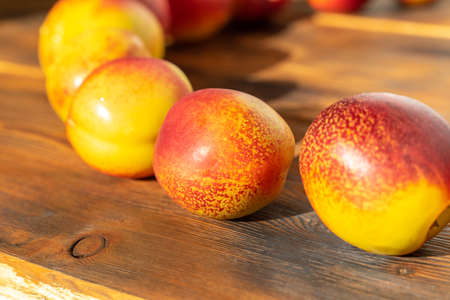 ripe juicy nectarines on a wooden background. harvest of fruits. close-up Stock fotó