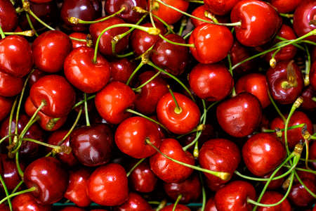 Red cherries in full screen. The texture of cherries.