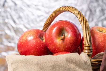beautiful ripe red apples in a basket close up Stock fotó