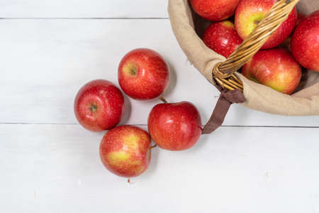 red juicy fresh apples on wooden background
