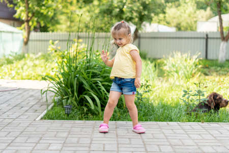 Little girl dances in the country. children's dances in nature