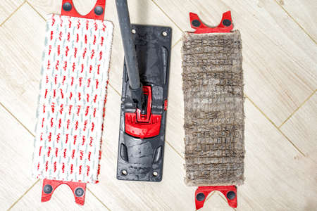 replacing the floor cleaning cloth. Mop for floor cleaning - old and new