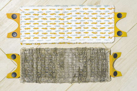 old and new mop cloths lie side by side on the floor