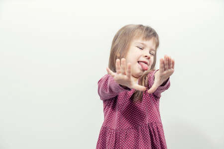 the child says no. hands forward. rejection pose. mock up with copy space