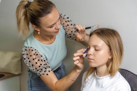 alignment of face tone. professional makeup process