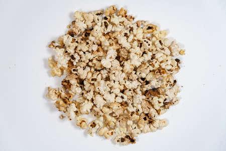 spoiled burnt popcorn grains on white background Foto de archivo