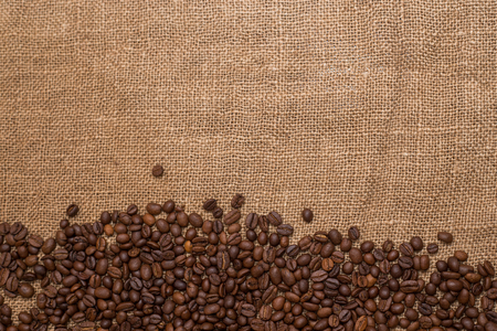 the warmth: coffee beans brown burlap fabric Natural texture close a lot of grain rustic warmth Stock Photo