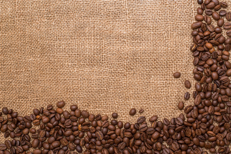 warmth: coffee beans brown burlap fabric Natural texture close a lot of grain rustic warmth Stock Photo