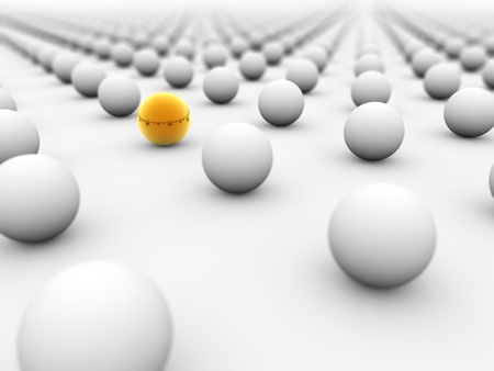 individuality: Golden ball surrounded by white ones with the focus on it.