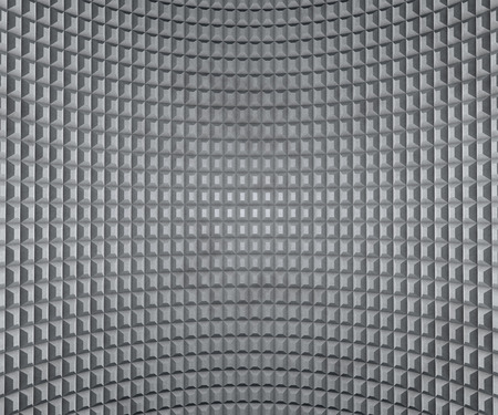 extruded: Grey inflected wall with extruded squares texture.