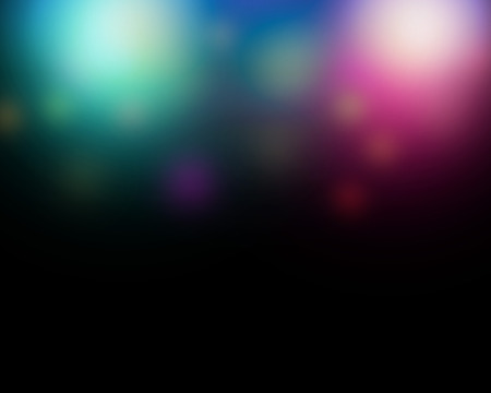 Abstract blurred color lghts background with black copy space.