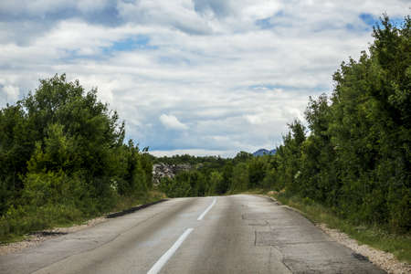 a broken road in the mountains of Republika Srpska Stock Photo