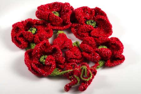 Festive handmade crocheted red flowers, ribbon, roses, poppy composition on the white background. Birthday, Mother's, Valentines, Women's, Wedding Day concept.. 版權商用圖片