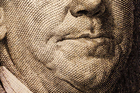 The texture of the fragment of the dollar bill. fragment of one hundred American dollars. Can inform about fiscal and monetary policy of the country, currency inflation rate and cross currency rate
