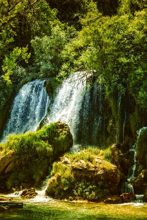Kravice waterfall on the Trebizat River in Bosnia and Herzegovina in autumn. Miracle of Nature in Bosnia and Herzegovina. The Kravice waterfalls, originally known as the Kravica waterfalls Фото со стока