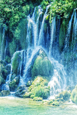 Kravice waterfall on the Trebizat River in Bosnia and Herzegovina. Miracle of Nature in Bosnia and Herzegovina. The Kravice waterfalls, originally known as the Kravica waterfalls. Soft focus. Фото со стока
