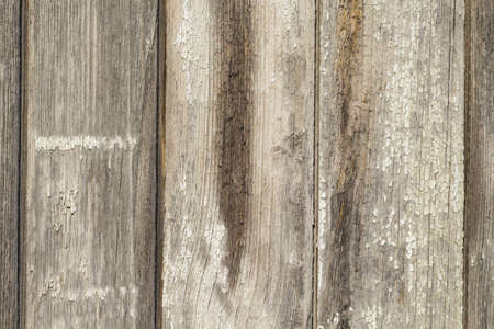 Old wooden background with scratches and cracks. Wooden table or floor.