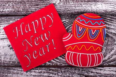 Inscription New Year and gingerbread. Winter sweet red glove. Sweet congratulations