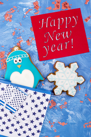 New Year gingerbread cookies with greetings. Gingerbread on a rusty background. Congratulations on the holiday.