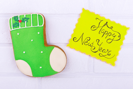 Lazy sweet New Years boot. Sweet food with New Years inscription. Inscription New Year and gingerbread Stock Photo
