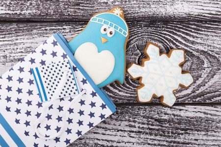 New Year gingerbread in a gift bag. Penguin and snowflake in the package. A gift to a child for Christmas Stock Photo