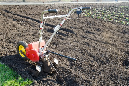 Motor cultivator for the spring plowing. The concept of gardening, gardening, farming, environmentally friendly food