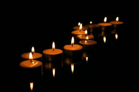 Candles in the dark. Memorial, hope, memorial symbol