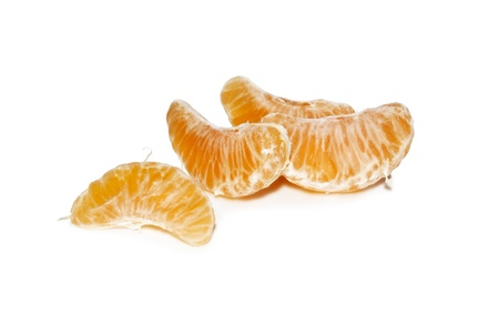 Slices of tangerine isolated on white isolated background  Stock Photo