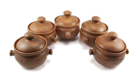 stoneware: Row of clay pots  isolated on white background Stock Photo