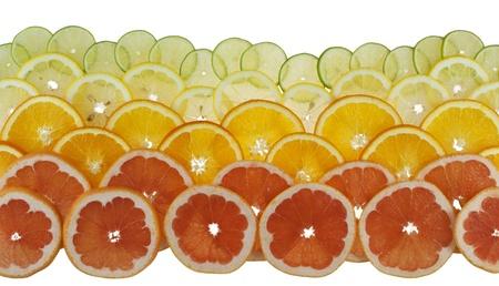 Background with citrus-fruit of  grapefruit, orange, lemon and lime slices   Stock Photo