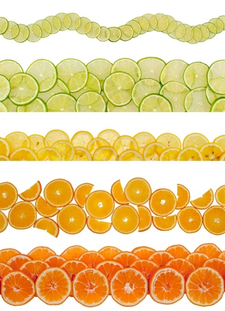 Slices of various citruses on white background