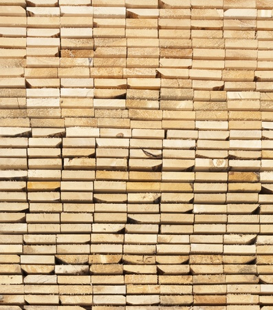 Background  of a stack  Of Wooden Boards From Ends  Stock Photo