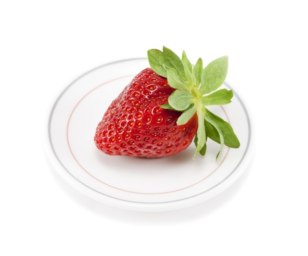 Strawberries on a plate on white isolated background