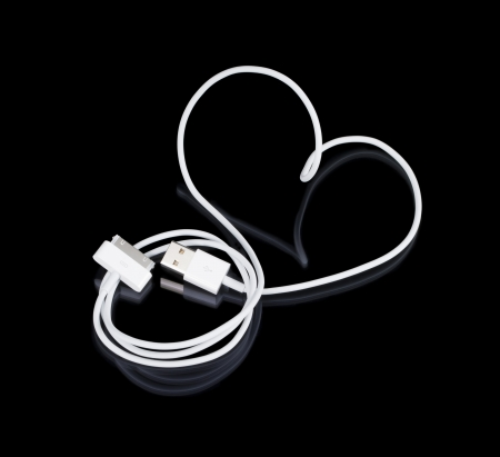 The white cable is a heart-shaped with connectors on a black background