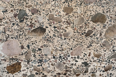 Old vintage wall of large and small granite stones, background Stock Photo